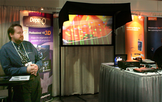 Lightspeed's President Chris Ward with the new DepthQ<sup>&reg;</sup> HDs3D2 projector, combined with the DepthQ<sup>&reg;</sup> Polarization Modulator and a Stewart silver 3D screen at Siggraph 2010